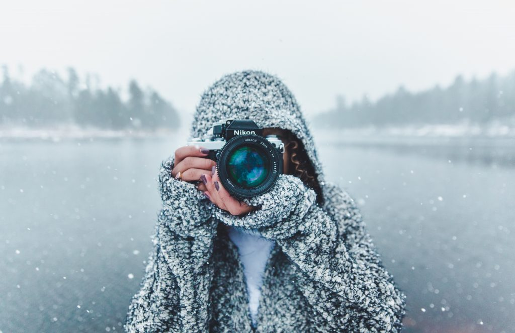Photographer in snowy conditions from unsplash.com
